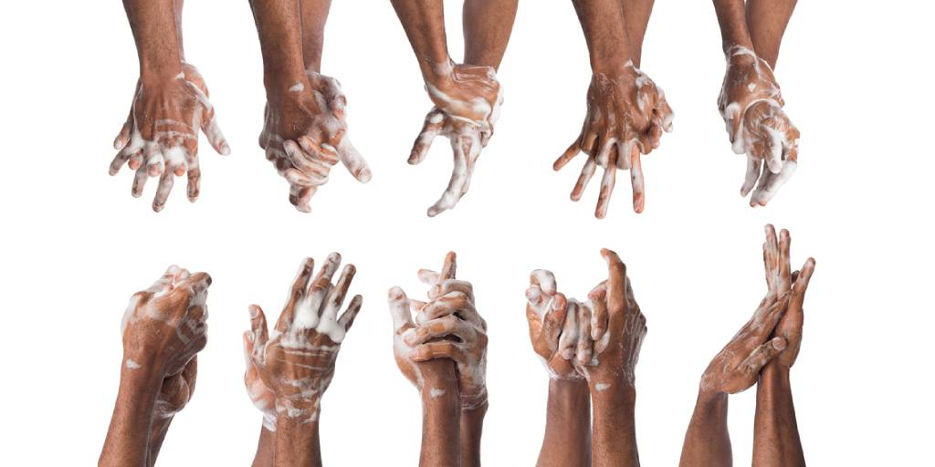 mens hands being washing in foaming soap