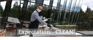 waiter cleaning tables with sanispray