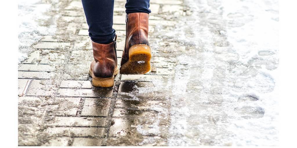 brown boots walking on icy walkway