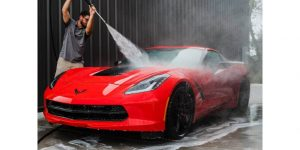 red corvette being washed